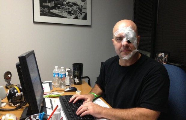 Rod's face covered in tape and sticky notes attempts to do the sports