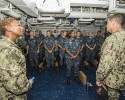 150909-N-MD297-066 MANAMA, Bahrain (Sept. 9, 2015) Fleet Master Chief April Beldo, left, and Vice Adm. Bill Moran, Chief of Naval Personnel, speak to chief petty officer selectees onboard Wasp-class amphibious assault ship USS Essex (LHD 2) during an in port visit. Essex is the flagship of the Essex Amphibious Ready Group (ARG) and, with the embarked 15th Marine Expeditionary Unit (MEU), is deployed in support of maritime security operations and theater security cooperation efforts in the U.S. 5th Fleet area of operations. (U.S. Navy photo by Mass Communication Specialist 2nd Class Huey D. Younger Jr./Released)